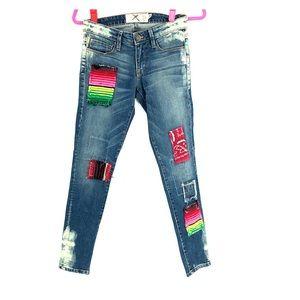 Free People medium wash patchwork skinny jeans